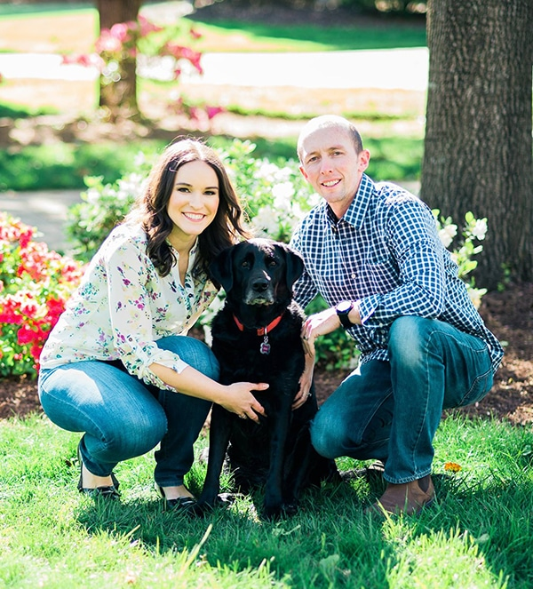 picture of lindsay, her husband and black lab outside